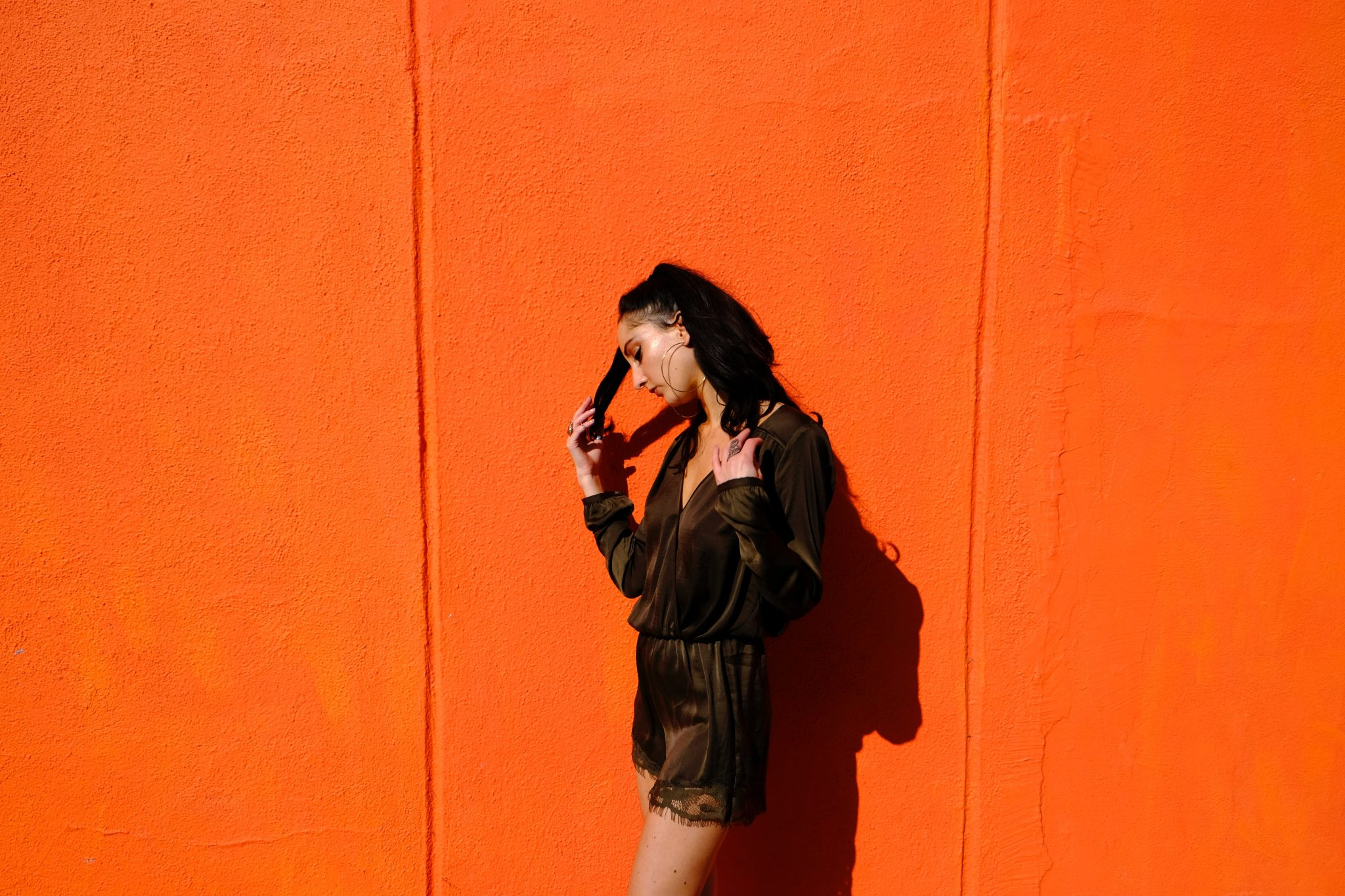 woman near orange wall